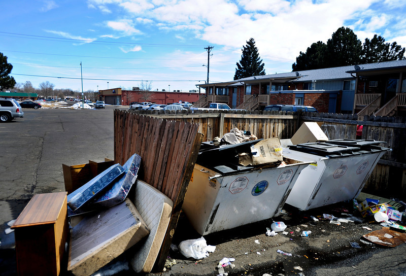 Old mattresses, furniture and other trash piles up around a dumpster at 1839 Terry St. in Longmont on Saturday, March 2, 2013. (Greg Lindstrom/Times-Call)