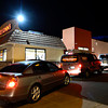 Cars wait in line for the drive-through at Taco John's along Main Street in Longmont on Wednesday, Jan. 23, 2013. General manager Jeff Pini said Tuesday's grand opening was the second best out of all 410 franchises. (Greg Lindstrom/Times-Call)