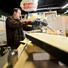 Colorado Actors Theatre owner Robert Bubon builds a stage at the company's new location at the Pacific Events Center, 1330 Main St. in Longmont, on Thursday, March 7, 2013. (Greg Lindstrom/Times-Call)