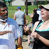 Globe/T. Rob Brown The Rev. Robert Sathuri (left) from First United Methodist Church in Elgin, Ill., tells a funny story to Joplin home owner Emily Morrison Monday morning, June 10, 2013, as they take a water break from working on her home. The church youth group is working in conjunction with Rebuild Joplin.