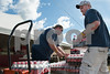 Kate Lovering/Finger Lakes Times                                                       Fire Captain Ray Kriegelstein (left) and Assistant Chief Matt Burlew (right) set up the the Seneca Falls Fire Department refreshment booth in preparation for Empire Farm Days beginning tomorrow in Seneca Falls, NY August 5, 2013.