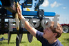 "Kate Lovering/Finger Lakes Times                                                       Sam Feeney, 13 of Jordan-Elbridge, cleans a Landoll ""Ripoll""  in preparation for Empire Farm Days beginning tomorrow in Seneca Falls, NY August 5, 2013. Sam and 3 of his cousins have been helping since last week to set up for their grandfather Dick Ottman's company R.B. Ottman, Inc. based in Elbridge, NY."