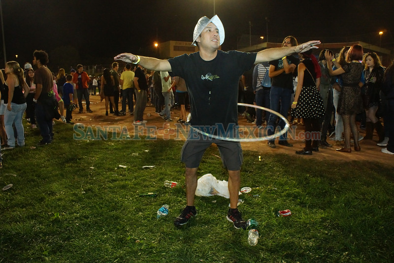 People smoke pot during the annual 90th burning of Zozobra at Ft. Marcy Park, Santa Fe on Friday August 29, 2014. On Wednesday August 27, the city council of Santa Fe voted 5 to 4 for decriminalization of marijuana. Photo by Luke E. Montavon/The New Mexican