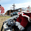 Globe/T. Rob Brown A Christmas Teddy bear rests on the hood of a tornado-destroyed van as a U.S. flag waves in the wind Monday morning, May 30, 2011, outside the tornado-stricken St. Mary's Catholic Church on 26th Street in Joplin.