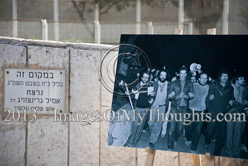 "A plaque marks the location of the murder of peace activist Emil Grunzweig alongside an enlarged photo of the 1983 demonstration depicting Grunzweig in what is probably his last photo alive. Jerusalem, Israel. 10-Feb-2013.<br /> <br /> ""Peace Now"" leads a 30-year commemoration ceremony for activist Emil Grunzweig, murdered in 1983 by a grenade thrown by right-wing activist Yona Avrushmi at demonstrators calling for the resignation of Defense Minister Ariel Sharon."