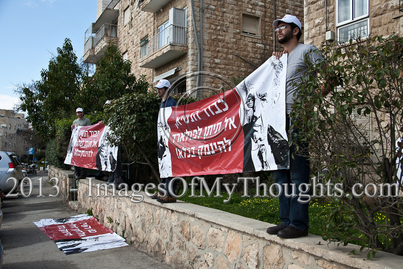 Activists wave banners demanding the release of Jonathan Pollard from US prison at the entrance to the President's Residence as a US Senate delegation meets with the President Shimon Peres. Jerusalem, Israel. 17-Feb-2013.<br /> <br /> Jonathan Jay Pollard, an American born in 1954, was a civilian intelligence analyst. He was convicted of spying for Israel and received a life sentence in the US in 1987.