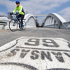 Globe/T. Rob Brown John Robb, a Pittsburg, Kan., cyclist, rides across the Rainbow Bridge on Route 66 near Baxter Springs, Kan., Monday afternoon, April 1, 2013.