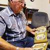 Globe/T. Rob Brown Charlie Bridges of Diamond looks through a World War I-era family photo album of his father Walter Bridges, who was a World War I veteran, Monday morning, Aug. 5, 2013.