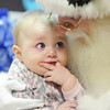 Nine-month-old Adelyn Carolus of Joplin looks up at Father Christmas as he holds her in the pediatric unit at Freeman West in Joplin on Monday afternoon, Dec. 23, 2013. Globe | T. Rob Brown