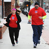 Justin and Laura Venneman of Webb City run Monday morning, Dec. 30, 2013, in downtown Joplin.<br /> Globe | T. Rob Brown