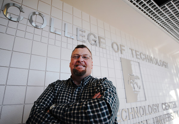 College of Technology student Terry Killman has battled leukemia for three years but will graduate this week from PSU. Globe | T. Rob Brown