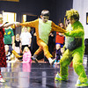 Joey Williams (right), 14, of Neosho, portrays the Grinch and Kailan Peters (left), 10, of Carl Junction, portrays Cindy Lou Who as they swing Max the dog, played by Xavier Huffman, 10, of Pittsburg, Kan., during a rehearsal for the ballet version of The Grinch Monday evening, Dec. 2. 2013, at the Midwest Regional Ballet owned by Kaye Lewis, artistic director.<br /> Globe | T. Rob Brown