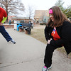 Justin and Laura Venneman of Webb City stretch before going for a run Monday morning, Dec. 30, 2013, in downtown Joplin.<br /> Globe | T. Rob Brown