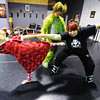 Kaye Lewis (right), artistic director, works with Joey Williams (center), 14, of Neosho, who portrays the Grinch and Kailan Peters, 10, of Carl Junction, portraying Cindy Lou Who during a rehearsal for the ballet version of The Grinch Monday evening, Dec. 2. 2013, at the Midwest Regional Ballet owned by Kaye Lewis, artistic director.<br /> Globe   T. Rob Brown