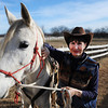 Marcia Weeks of Pittsburg, Kan., stands next to Zara, her Arabian mare, Wednesday afternoon, Dec. 19, 2013, at the stables in rural Kansas where she keeps her two horses. Globe | T. Rob Brown