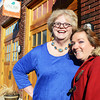 "Niki Corcoran (right) smiles next to one of her mentors Ann Leach, both of Joplin, next to ""the carriage house"" offices behind the Gryphon Building in downtown Joplin Tuesday afternoon, Dec. 31, 2013. Globe 