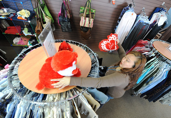 Globe/T. Rob Brown<br /> Betsy Bonin, cashier for the Hope Chest Thrift Store and a Hope House Ministries resident, organizes a store display Monday morning, Feb. 4, 2013. Bonin said she is expected to graduate from the program on Feb. 20, 2013. The ministry and thrift store are part of Helping Hands Housing Inc. which recently moved its thrift store to East 7th Street.