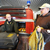 Stark City Fire Chief James Palmer (left) and Fairview Fire Chief Greg Kruse look through firefighting gear that needs replacing Thursday afternoon, Jan. 9, 2014, at the Stark City Fire Department. The two departments are hoping to combine and get a tax levy to make the necessary upgrades.<br /> Globe | T. Rob Brown