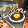 "A copy of the Beatles' hit, ""I want to Hold Your Hand,"" rests on the turntable of Mark Woodin's original Beatles phonograph at his Joplin home. Globe 