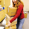 Joplin school bus driver Tammy Thompson helps bring in boxes of school items to the new Soaring Heights Elementary School Thursday afternoon, Jan. 2, 2014, in Duquesne. Soaring Heights combines the students from Duquesne and Duenweg elementary schools.<br /> Globe | T. Rob Brown