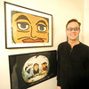 Mark Woodin stands beside an original Ringo Starr work of art (top) in his Joplin home. Globe | Laurie Sisk