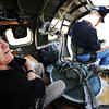 "Globe/T. Rob Brown Richard La Near (left) looks around a gunnery station as his father Ken La Near puts on a seatbelt in preparation for a father-son flight in a restored B-17G, ""Sentimental Journey"" Friday morning, June 14, 2013."