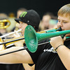 Globe/T. Rob Brown Matthew Robertson, MSSU junior music education major, plays a special green Jiggs pBone trombone along with the rest of the MSSU Pep Band during a recent MSSU basketball game at Leggett & Platt Athletic Center.