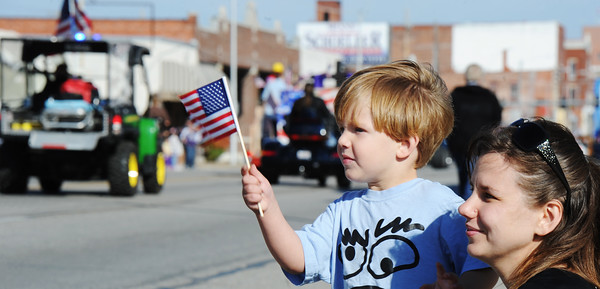 Globe/T. Rob Brown<br /> Three-year-old Carter Close, waves a US flag as he and his mother, Cassie Ford, both of Joplin, watch the 25th Annual Veteran's Day Parade Saturday morning, Nov. 10, 2012, on Main Street in downtown Joplin.