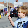 Globe/T. Rob Brown Three-year-old Carter Close, waves a US flag as he and his mother, Cassie Ford, both of Joplin, watch the 25th Annual Veteran's Day Parade Saturday morning, Nov. 10, 2012, on Main Street in downtown Joplin.