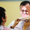 Dr. Phil Cook, Carl Junction School District superintendent, takes a pie to the face from Carl Junction Postmaster Sharon Clark Wednesday morning, Nov. 6, 2013, at the Carl Junction Community Center gymnasium. The event was in recognition of the Carl Junction post office selling the most breast cancer awareness stamps in the nation.<br /> Globe   T. Rob Brown