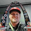 Shane Munn, Ignite Church campus pastor and St. Louis Cardinals baseball fan holds up a commemorative World Series Champions arch replica from the All-Star Game. Globe | T. Rob Brown