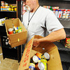 Ted Londo, pantry manager, carries out boxes of canned goods for clients Friday, Nov. 8, 2013, at Soul's Harbor in Joplin. Globe | T. Rob Brown