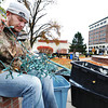 Seasonal city of Joplin employee Jarred English helps separate holiday lights and check to make sure they still work Wednesday afternoon, Nov. 20, 2013, in Spvia Park, downtown Joplin. Globe | T. Rob Brown