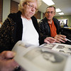Kay and James Beeler, both of Joplin, look through images recovered during the Joplin tornado as part of the Lost Photos of Joplin Project Friday morning, Nov. 22, 2013, at the Joplin Museum Complex in Schifferdecker Park. Globe | T. Rob Brown