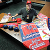 Shane Munn, Ignite Church campus pastor and St. Louis Cardinals baseball fan, with a portion of his memorabilia. Globe | T. Rob Brown