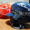 Autographed miniature helmets from the memorabilia collection of Shane Munn, Ignite Church campus pastor and St. Louis Cardinals baseball fan. Globe | T. Rob Brown