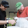 Father-and-son art duo Trip Vaile of Springfield (left) and Earnie Vaile of Carthage chisel away on the likeness of a recreational vehicle Wednesday afternoon, Oct. 16, 2013, at the Joplin home of Jorge Leyva. Globe | T. Rob Brown