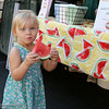 Ayla Scarborough, 11 months, has a mouth full of watermelon at Slice of Chico on Saturday, July 12, 2014, in Chico, California. Dan Reidel – Enterprise-Record
