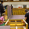 "The cast and crew of ""The World by the Tale"" remove the hardware holding the stage together and prepare to move the pieces from the Crawford auditorium into a box truck for transportation to Harrison where they will repeat the performance."