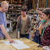 Season Scenic Designer Mark Delance, left, explains the use of math in scaling his drawings to actual construction size stage scenery to four Upward Bound students last week during a backstage tour of the Post Playhouse at Fort Robinson State Park. (Frank Bright/Chadron State College)