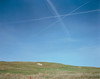 """Contrails over the High Plains is one photo by Peter Brown featured in """"West of Lance Chance,"""" a coffee table book on loan along with several large format photos from the Museum of Nebraska Art. The exhibit in the Sandoz Center is open until Aug. 12."""
