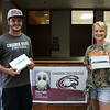About150 students qualified for an iPad drawing by having their EagleCard ID photos taken last semester. The two drawing winners are, from left, Brewer Newton of Houston, Texas, and Ashlee Wright of Alliance, Nebraska. (Tena L. Cook/Chadron State College)