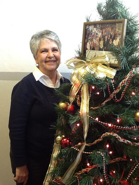 Sharon Rickenbach, a CSC Golden Eagle, poses with that group's tree in the basement level of the Dawes County Courthouse. The Winter Festival of Trees is a fundraiser for the Fur Trade Days committee. Two other CSC exhibits are a tree on the main level and a garland on the third floor.