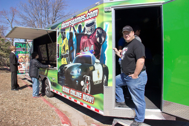 "Chadron State College alumnus Dale ""Bull"" Chaney of Valentine returned to campus with his game trailer Dozers games for the Scholastic Contest Friday. (Tena L. Cook/Chadron State College)"