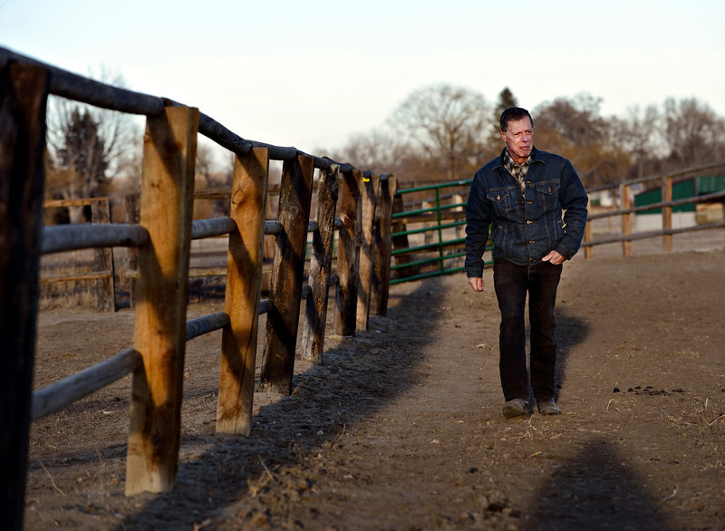 Bill Berg walks along his property while finishing his evening chores at Ridge Ranch in Hygiene on Thursday, Jan. 31, 2013. For more photos and a video visit www.dailycamera.com. (Greg Lindstrom/Times-Call)