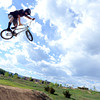 Shawn Neer, of Boulder, throws a trick over a jump on his bmx bike on Monday, May 21, at the Valmont Bike Park in Boulder. For more photos and video of the park go to www.dailycamera.com Jeremy Papasso/ Boulder Daily Camera