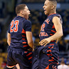 Central Catholic's Kevin Fernandez (23) and Alex Santos (32) celebrate their 79-66 win over Catholic Memorial in the Division 1 State semifinals at the TD Garden in Boston.