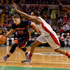 Central Catholic's Kevin Fernandez (23) drives against Catholic Memorial's Brandon Twitty.