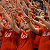 RYAN HUTTON/ Staff photo. Central Catholic fans raise their hands in silence as Centeral puts up a free-throw during the fourth period of Saturday night's state final game against Putnam.
