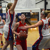RYAN HUTTON/ Staff photo.    Pinkerton's Valerie Martion (25) tries to put up a shot past Londonderry defenders Talyor Collins (20) and Casey Evans (33) during the first half of Thursday night's game.